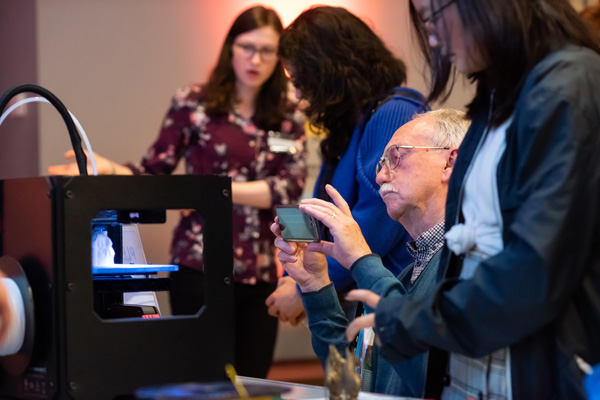 Visitors interacting with digital technologies during a 'Thinking 3D' Bodleian Lates event