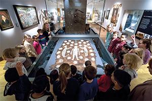 Visitors looking at exhibit