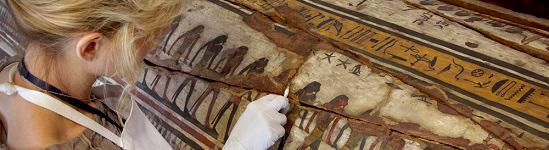 Archaeologist working on Egyptian artifact