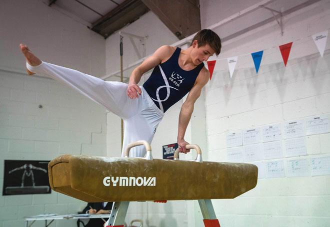 Gymnast training on pommel horse