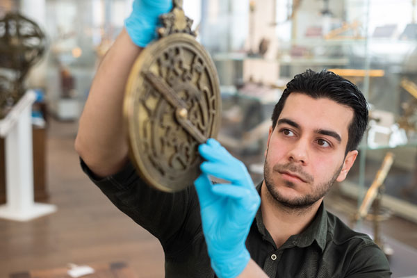 Researcher with astrolabe
