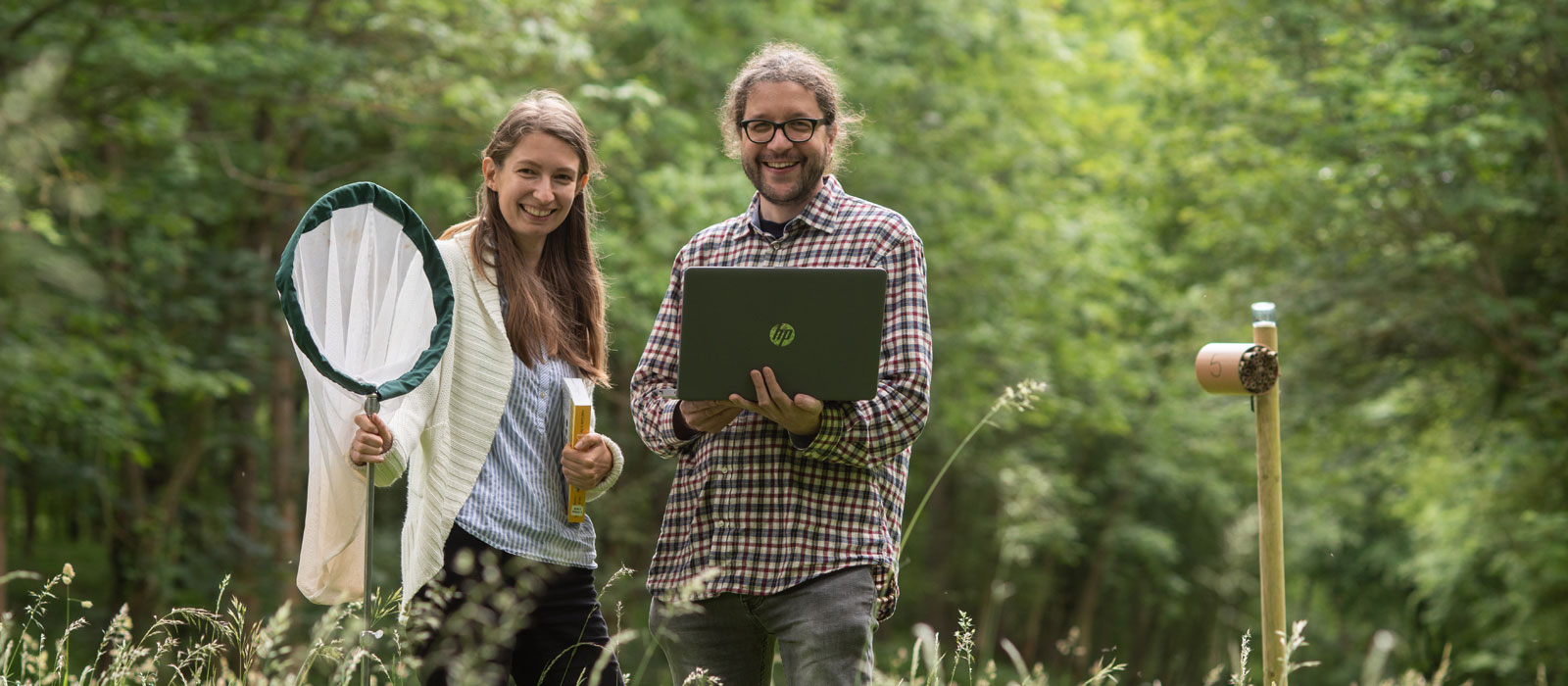 Dr Matthias Becher and Sabrina Dietz in Wytham Woods. Photo by John Cairns.
