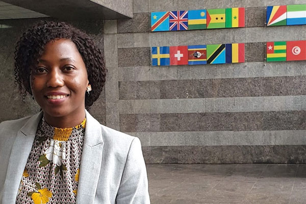 Swarovski Scholar graduate Claire Nakabugo standing in the reception of the African Development Bank.