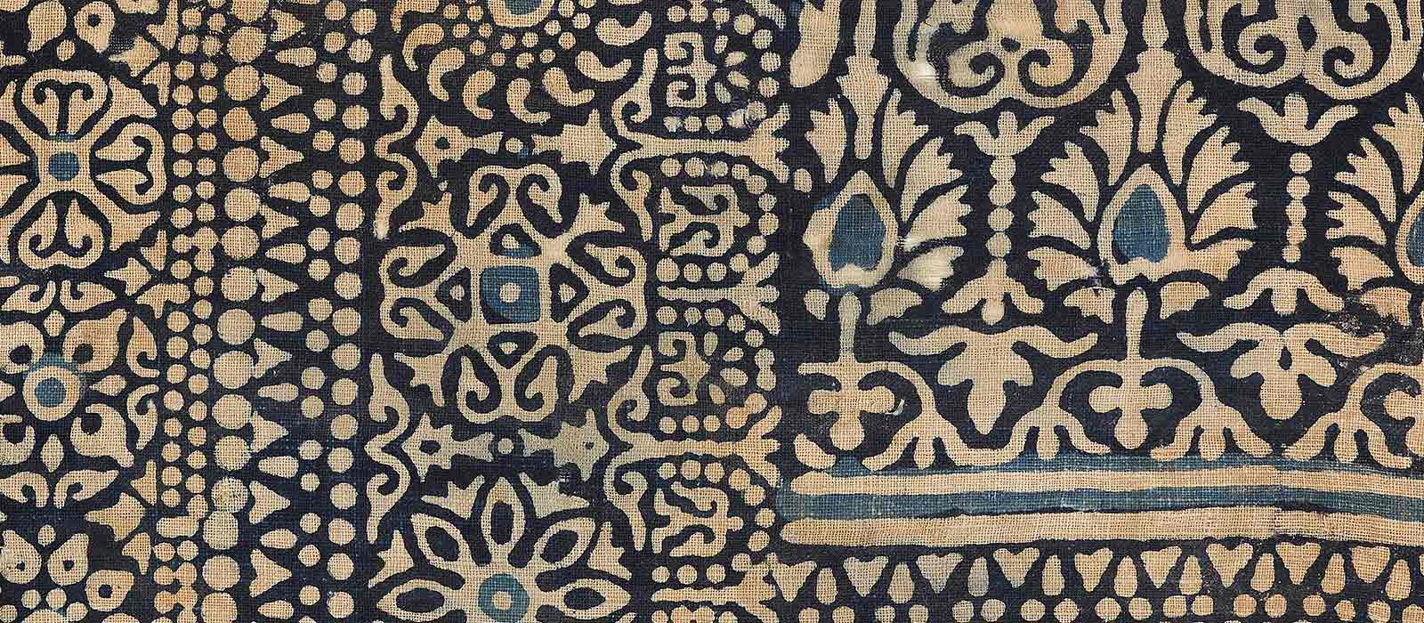 A black and blue block-printed Gujarati cotton textile fragment from the Ashmolean Museum's collections